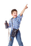 Boy standing with spyglass and pointing Stock Photos