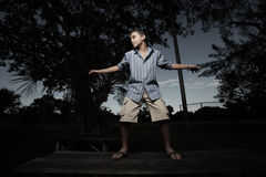 Boy standing on a table Royalty Free Stock Photography