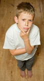 Boy standing and thinking Royalty Free Stock Photo