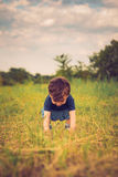 Boy standing up in a field. Boy standing up in a grass field on a beautiful day Stock Images