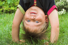 Boy standing upside down Stock Photos