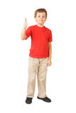 Boy standing on white thumbsup gesture Stock Photos