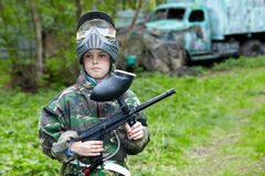 Boy stands against paintball area with old aba Stock Photos