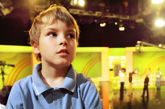 Boy stands in auditorium Royalty Free Stock Image