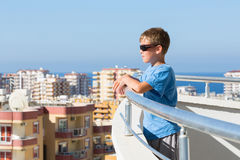 A boy stands on the balcony Royalty Free Stock Photography
