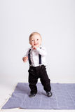 Boy stands on blanket on white background Stock Photo