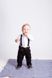 Boy stands on blanket on white background Royalty Free Stock Photo