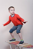 Boy stands on a board Royalty Free Stock Images