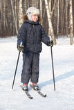 Boy stands on cross-country skis, winter Royalty Free Stock Images
