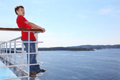 Boy stands on deck of ship and shouts Royalty Free Stock Photos