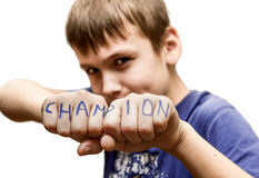 A boy stands in a fighting pose, with the words Royalty Free Stock Image