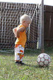Boy stands in football goals Royalty Free Stock Images