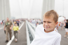 Boy stands on a Golden Bridge in Vladivostok Royalty Free Stock Photos