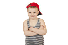 Boy stands with his hands folded on his chest Stock Photography