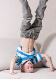 Boy stands on his head. Royalty Free Stock Photo