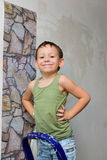 A boy stands on a ladder and glues wallpaper Royalty Free Stock Photography