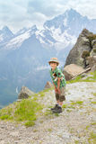 The boy stands on mountain path Stock Photography