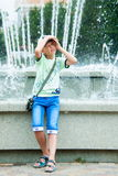Boy stands near a fountain Royalty Free Stock Photo
