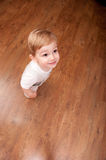Boy stands on parquet Stock Photo