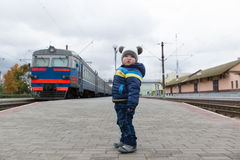 Boy stands on the platform Stock Photos