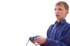 Boy stands and plays Stock Image
