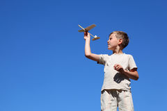 Boy stands and plays by home-made air Stock Images