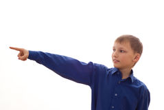 Boy stands and pointing forward Stock Photo
