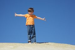 Boy stands on sand Stock Image