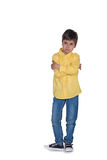 The boy  stands serious and offended Royalty Free Stock Photography