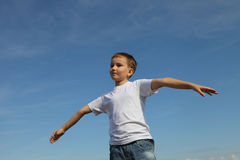 Boy stands in the sky Royalty Free Stock Images