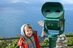 Boy stands at the telescope in Gibraltar Royalty Free Stock Images