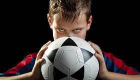 Boy stares with ball frontal Royalty Free Stock Photo