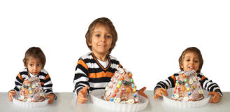 Boy staring  at cake at home. Isolated on a white background Stock Photography