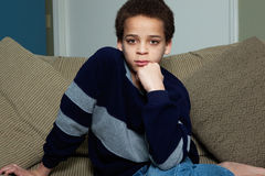 Boy staring into camera Stock Photography