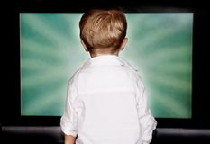 Boy staring at tv screen Stock Photo
