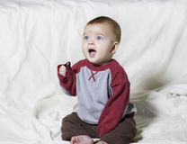 Boy staring in wonder. Cute young baby staring in wonder or amazement Royalty Free Stock Photos