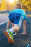 Boy on the start ready to run Royalty Free Stock Image