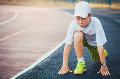 Boy on the start ready to run Royalty Free Stock Photos