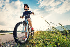 Boy start to ride a bicycle Stock Photos