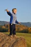 Boy starting small plane model Stock Photos