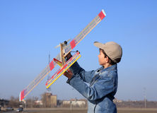 A boy starts an airplane. Royalty Free Stock Image