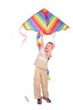 Boy starts kite royalty free stock photography