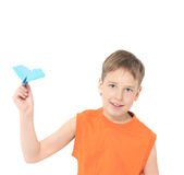 Boy starts paper plane Stock Images