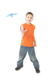 Boy starts paper plane Stock Photo