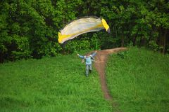 Boy starts to fly using parachute Stock Images