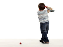 Boy stay back and preparing to hit a golf ball Royalty Free Stock Photos