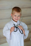 The boy  with stethoscope Stock Image