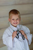 The boy  with stethoscope Stock Photos