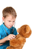 Boy with stethoscope and toy Stock Images