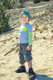 Boy with a stick walks on nature Royalty Free Stock Photography